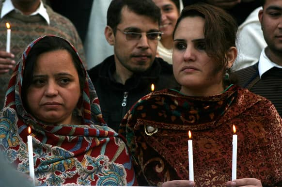 Pakistan NGO workers hold rally outside the Peshawar Club for their colleagues killed by gunmen, in Peshawar.