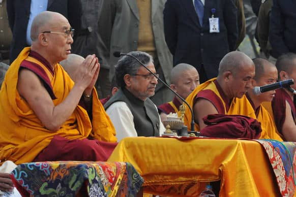 Tibetan spiritual leader the Dalai Lama offers prayers at the Buddha Smriti Park in Patna. The Dalai Lama is in the city to participate in the three day International Buddhist Conference beginning Jan. 5.