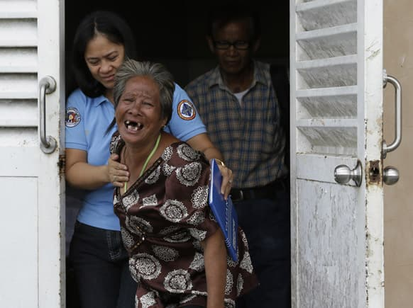 Aniolina Caimol, 63, the grandmother of shooting victim Micaela Caimol, 7, cries after viewing her grand daughter inside a morgue of a private hospital in Kawit township, Cavite province 16 kilometers (10 miles) south of Manila, Philippines.