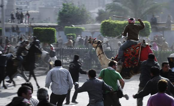 Supporters of President Hosni Mubarak, riding camels and horses, fight with anti-Mubarak protesters in Cairo, Egypt.