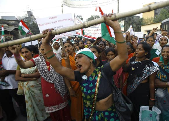 Protestors shout slogans during a march against slum evictions, land scams and other problems faced by the urban poor in Mumbai, India.