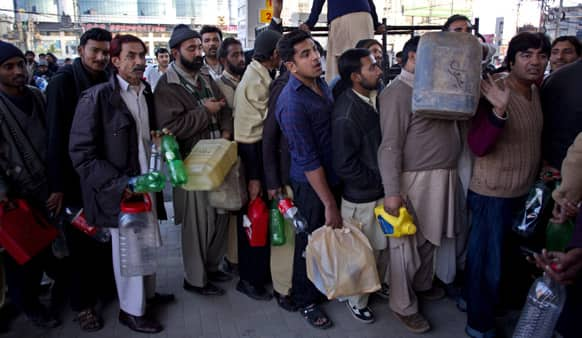 People queue at a gas station to get fuel in Rawalpindi. After severe shortage of Compressed Natural Gas (CNG) used in cars, now consumers are also facing shortage of gasoline.
