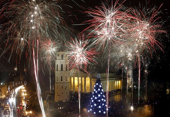 Fireworks light the sky above the Cathedral Square in Vilnius shortly after midnight, greeting the New Year.