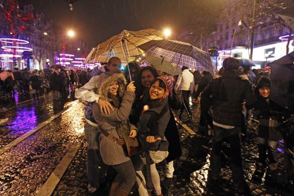 Revelers celebrate the New Year on the Champs Elysee in Paris.