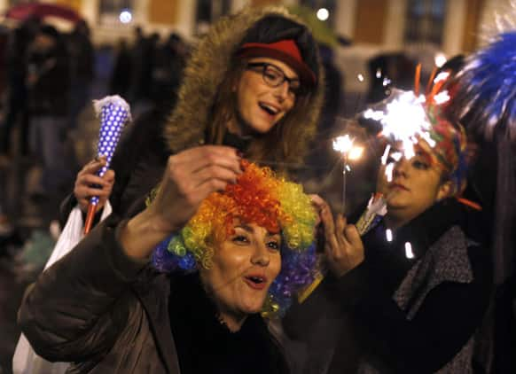 Revellers celebrate with fireworks during New Year's celebrations in Madrid, Spain.