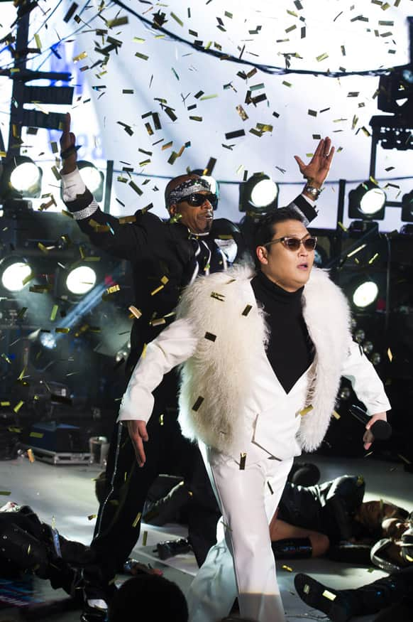 Psy and MC Hammer perform in Times Square during New Year's Eve celebrations, 2012 in New York.