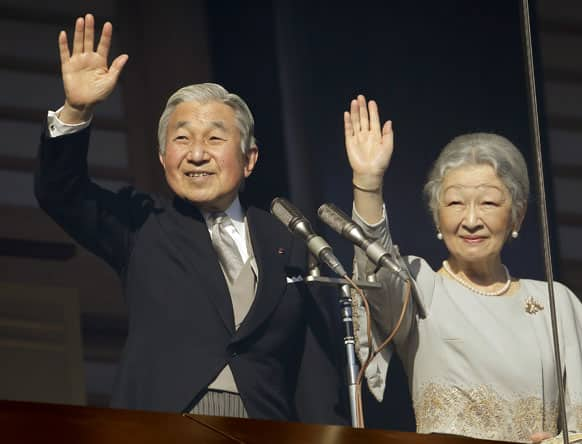 Emperor Akihito and Empress Michiko show at a balcony as they acknowledge to well-wishers for the new year's celebrations at the Imperial Palace in Tokyo.