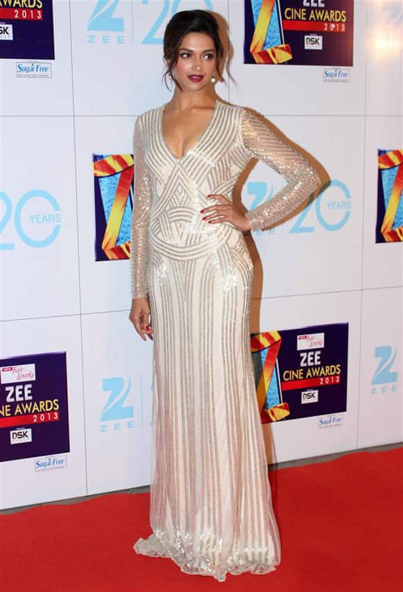 Deepika Padukone swept people off their feet in a sweeping off white and silver Naeem Khan creation.