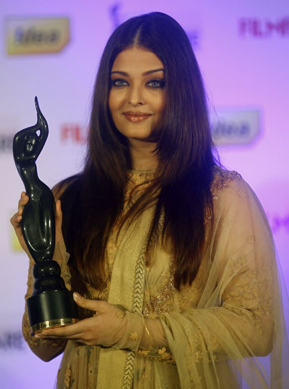 Aishwarya Rai Bachchan poses for a picture with the trophy of the 58th India Filmfare Awards during an event in Mumbai.