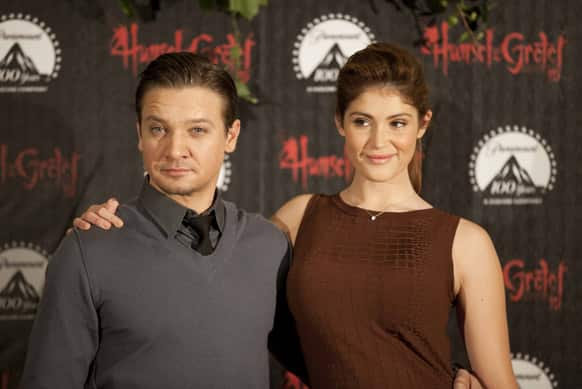U.S. actor Jeremy Renner, left, and British actress Gemma Arterton pose for photos during a photo call promoting her new movie,