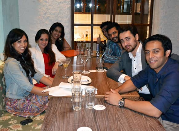 Bollywood actor Imran Khan (in a grey suit) is clicked having a quiet dinner to celebrate his birthday with his wife Avantika (in a red dress and a white blazer) and a few close friends at Cheval in Kala Ghoda, Mumbai.