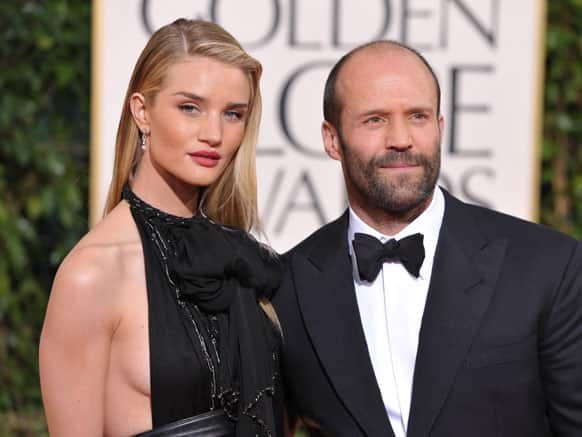 Actors Rosie Huntington-Whiteley, left, and Jason Statham arrive at the 70th Annual Golden Globe Awards at the Beverly Hilton Hotel.