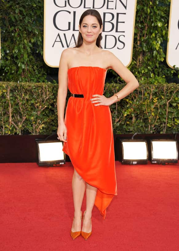 Actress Marion Cotillard arrives at the 70th Annual Golden Globe Awards at the Beverly Hilton Hotel .