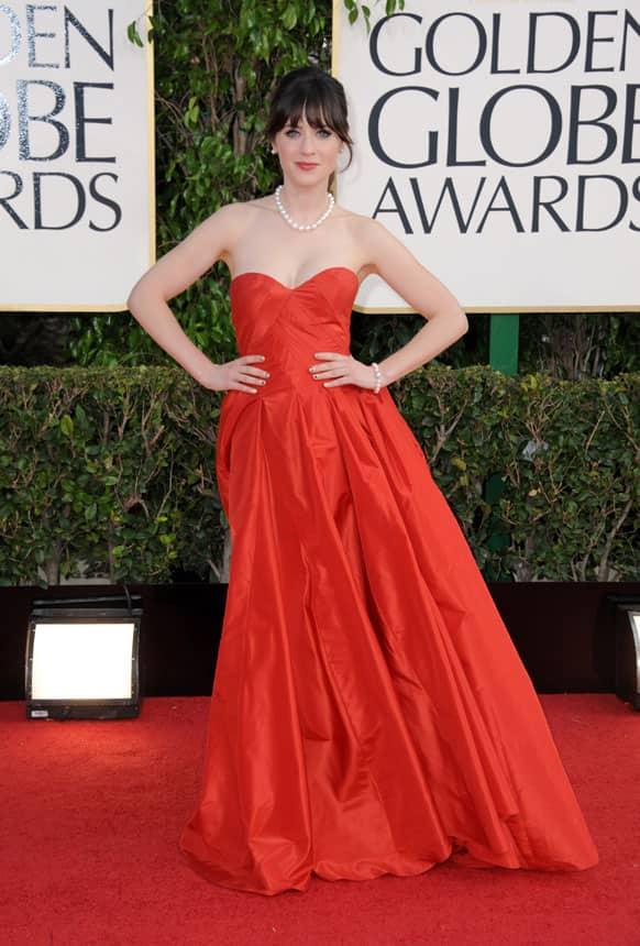 Actress Zooey Deschanel arrives at the 70th Annual Golden Globe Awards.
