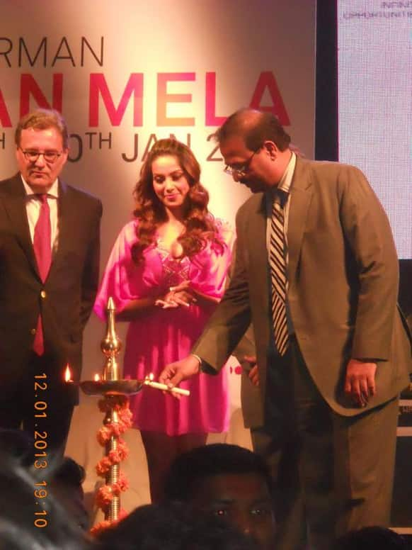 Bipasha Basu looks on as the inaugural lamp is lighted at the Indo-German Urban Mela in Pune.