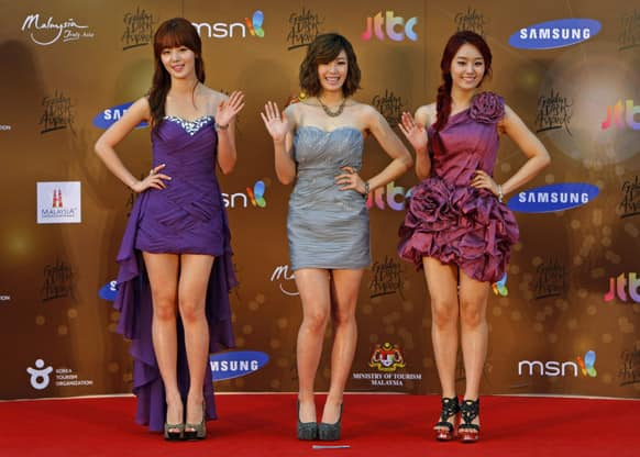 South Korean girl group Secret poses for photographers as they arrive on the red carpet ahead of the 27th Golden Disk Awards at Sepang International Circuit in Sepang, Malaysia.