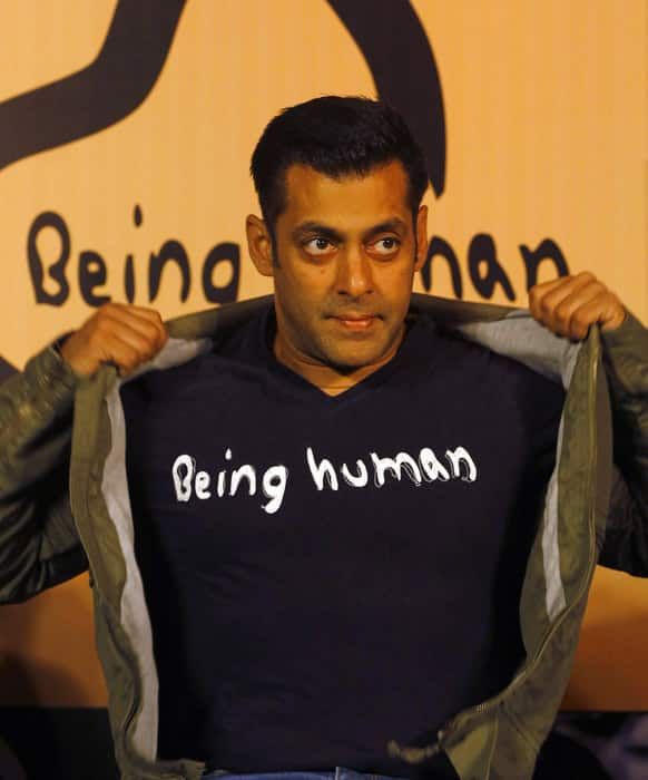 Salman Khan poses wearing a Being Human t-shirt during the launch of Being Human's first flagship store in Mumbai.