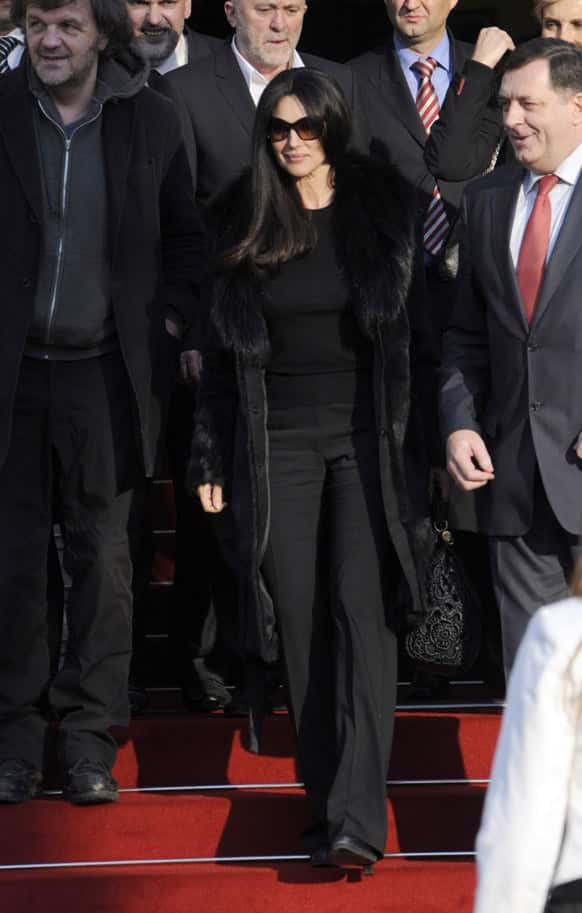 Italian actress Monica Bellucci accompanied with Milorad Dodik, right, president of the Republic of Srpska, right, and Emir Kusturica film director, left, during a visit to Bosnian town of Banja Luka, Bosnia.