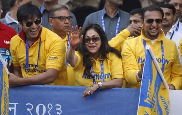Bollywood actors, from left, Vivek Oberoi, Tina Ambani and Gulshan Grover cheer up during the Mumbai Marathon.