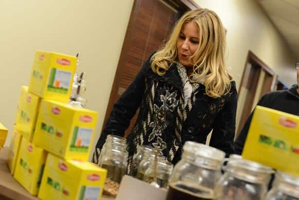 Actress Jennifer Coolidge gets excited over creating her own custom brew at the Lipton Uplift Lounge Tea Bar during Sundance in Park City, UT.