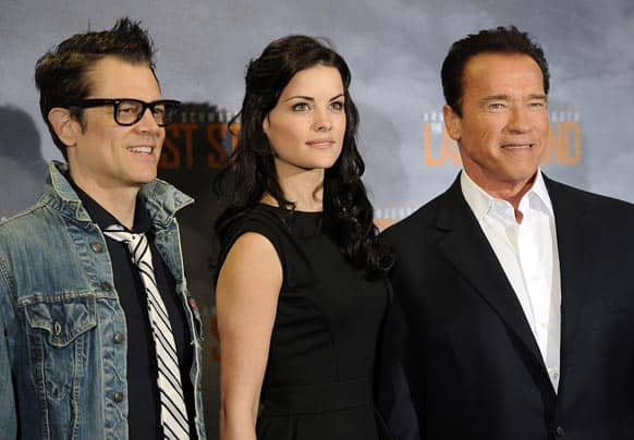 Actors Johnny Knoxville, Jaimie Alexander and Arnold Schwarzenegger, pose during a photo call for the movie