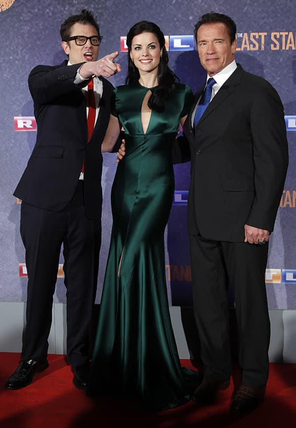 US actors Johnny Knoxville, Jaimie Alexander and Arnold Schwarzenegger pose for the media prior to the premiere of the movie 'The Last Stand' in Cologne, Germany.