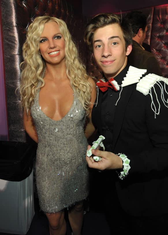 Jimmy Bennett, right, poses with a wax figure of Britney Spears at the after party for the LA premiere of