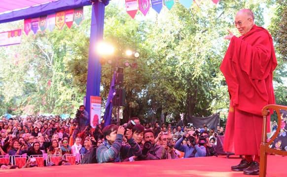 The Dalai Lama greets the audiences.