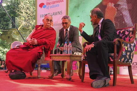 The Dalai Lama, listens to one of his biographers, Pico Iyer at one of the sessions on the opening day of India's Jaipur Literature Festival in Jaipur.