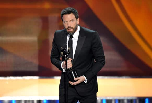 "Ben Affleck accepts the award for outstanding cast in a motion picture for ""Argo"" at the 19th Annual Screen Actors Guild Awards at the Shrine Auditorium."