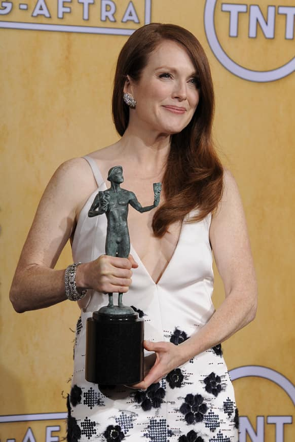 Actress Julianne Moore poses backstage with the award for best female actor in a TV movie or miniseries at the 19th Annual Screen Actors Guild Awards at the Shrine Auditorium.