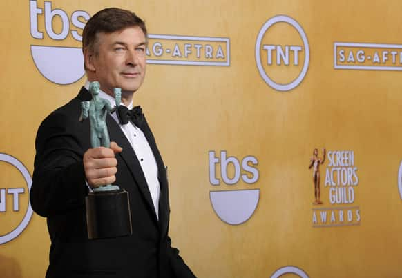 Actor Alec Baldwin poses backstage with the award for best male actor in a comedy series at the 19th Annual Screen Actors Guild Awards at the Shrine Auditorium.