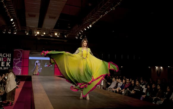 A Pakistani model presents a creation of designer duo, Faisal and Shabana, during Karachi Fashion Week.
