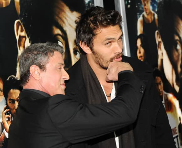 Actors Sylvester Stallone, left, and Jason Momoa attend the