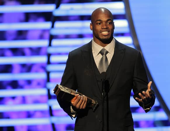 Adrian Peterson of the Minnesota Vikings accepts the NFL.com Fantasy Player of the Year award at the 2nd Annual NFL Honors in New Orleans.