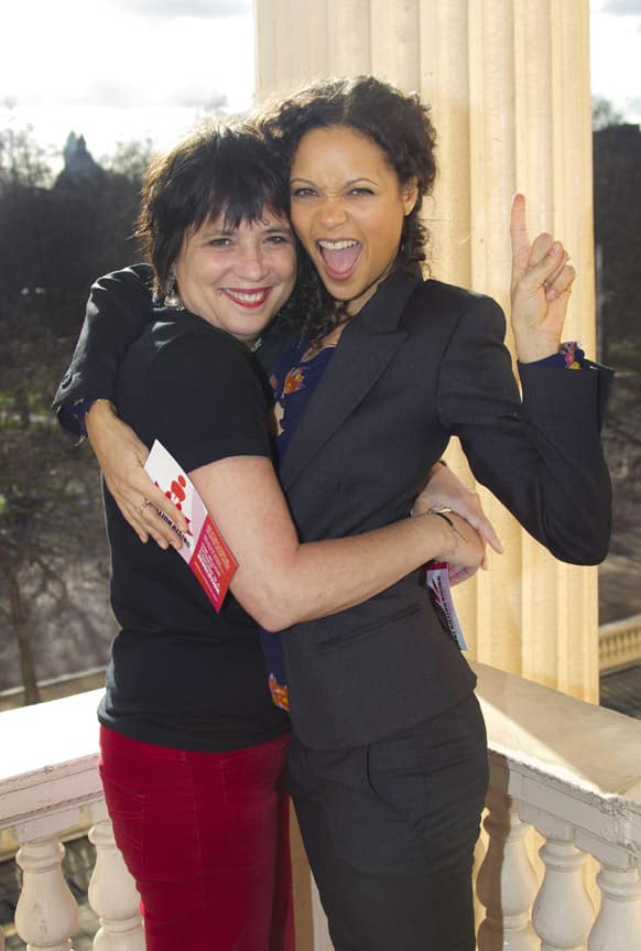 Actress Thandie Newton, right, reacts with playwright and charity founder, Eve Ensler, during a photocall for One Billion Rising, the charity which aims to tackle violence against women, at the Institute of Arts in central London.