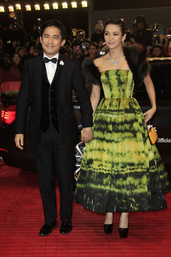 Actors Tony Leung and Zhang Ziyi arrive on the red carpet for the screening of the film The Grandmaster at the 63rd edition of the Berlinale, International Film Festival in Berlin.