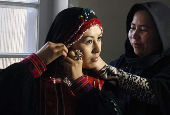 An Afghan model prepares prior a fashion show in Kabul, Afghanistan.