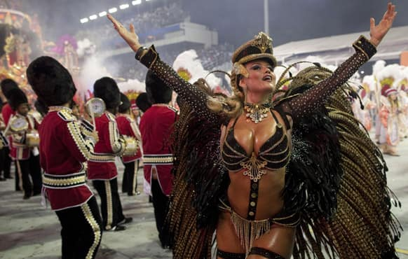 A dancer from the Rosas de Ouro samba school performs during a carnival parade in Sao Paulo, Brazil.
