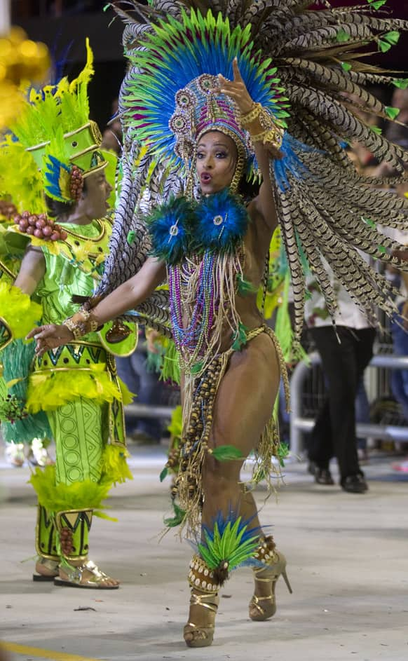 A dancer from the Vai-Vai samba school performs during a carnival parade in Sao Paulo, Brazil.