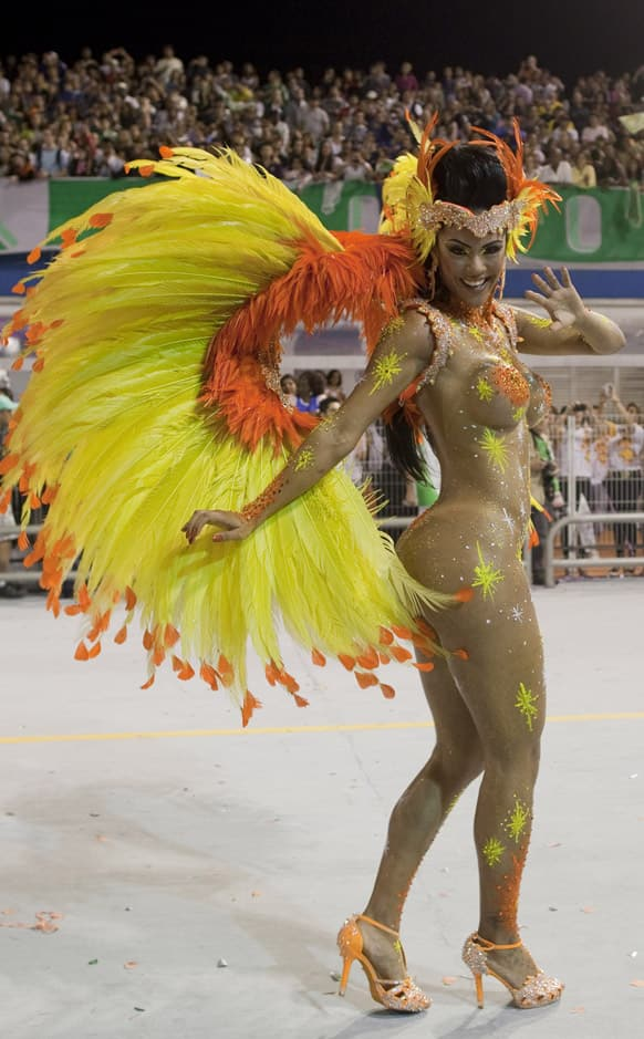 A dancer from the Mancha Verde samba school performs during a carnival parade in Sao Paulo, Brazil.