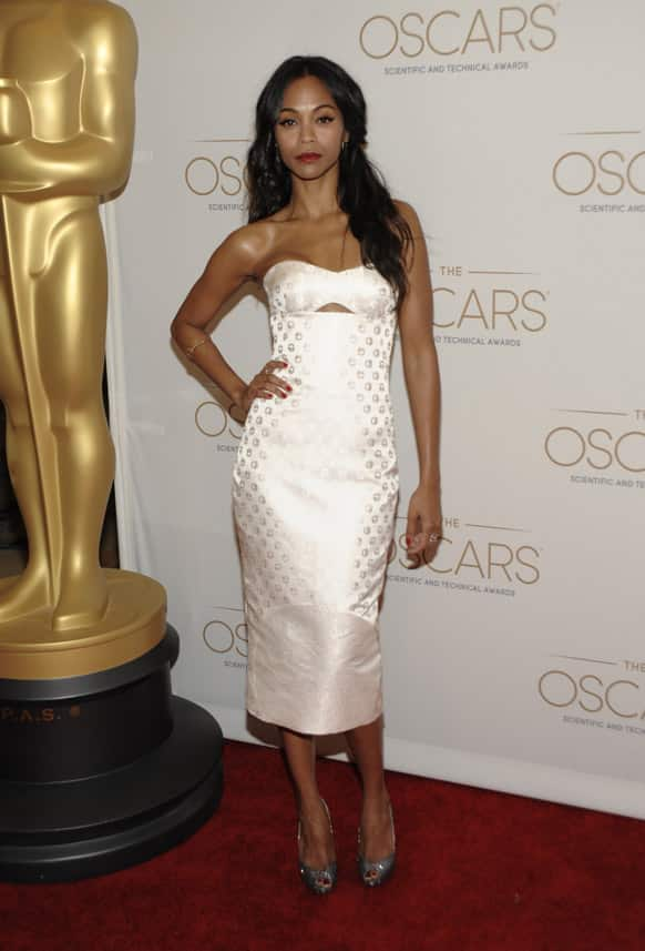 Actress and evening host Zoe Saldana arrives at The Academy of Motion Picture Arts and Sciences, Scientific and Technical Awards at The Beverly Hills Hotel in Beverly Hills, Calif.