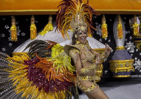 A dancer from the Gavioes da Fiel samba school performs during a carnival parade in Sao Paulo, Brazil.