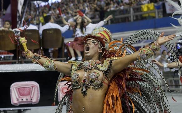 A dancer from the Gavioes da Fiel samba school performs during a carnival parade in Sao Paulo.