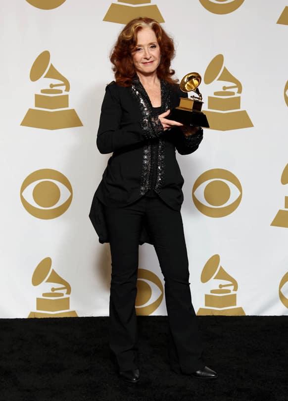 Bonnie Raitt poses backstage with the award for best americana album for