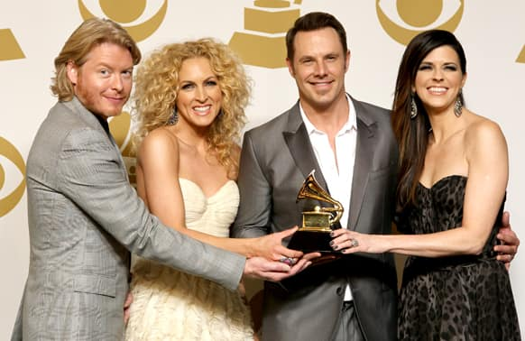 From left, Phillip Sweet, Kimberly Schlapman, Jimi Westbrook and Karen Fairchild, of musical group Little Big Town, pose backstage with the best country duo/group performance award for