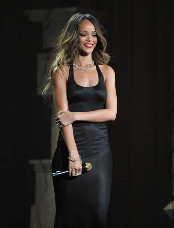 Rihanna performs on stage at the 55th annual Grammy Awards.