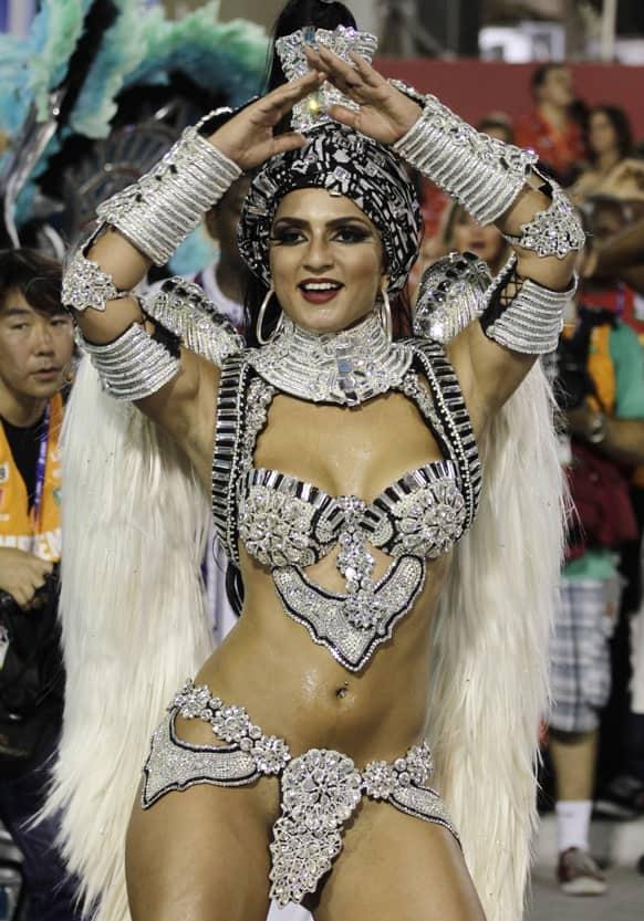 Performers from the Uniao da Ilha do Governador samba school parade during carnival celebrations at the Sambadrome in Rio de Janeiro.