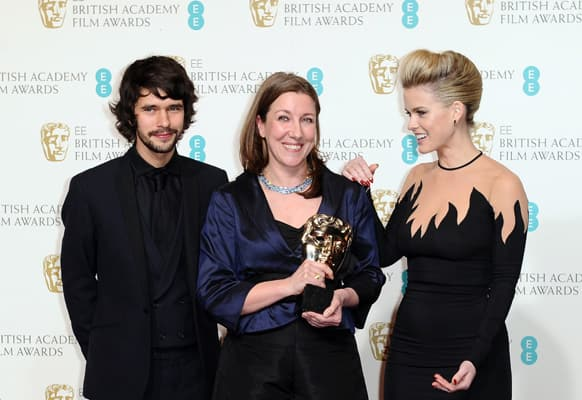 British actor Ben Whishaw, left, costume designer Jacqueline Durran, accepting the award for Make Up and Hair on behalf of Lisa Westcott, center, and actress Alice Eve pose backstage at the BAFTA Film Awards at the Royal Opera House.