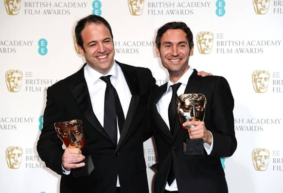 Producer Simon Chinn, left, and Swedish director Malik Bendjelloul pose with the award for Best Documentary for